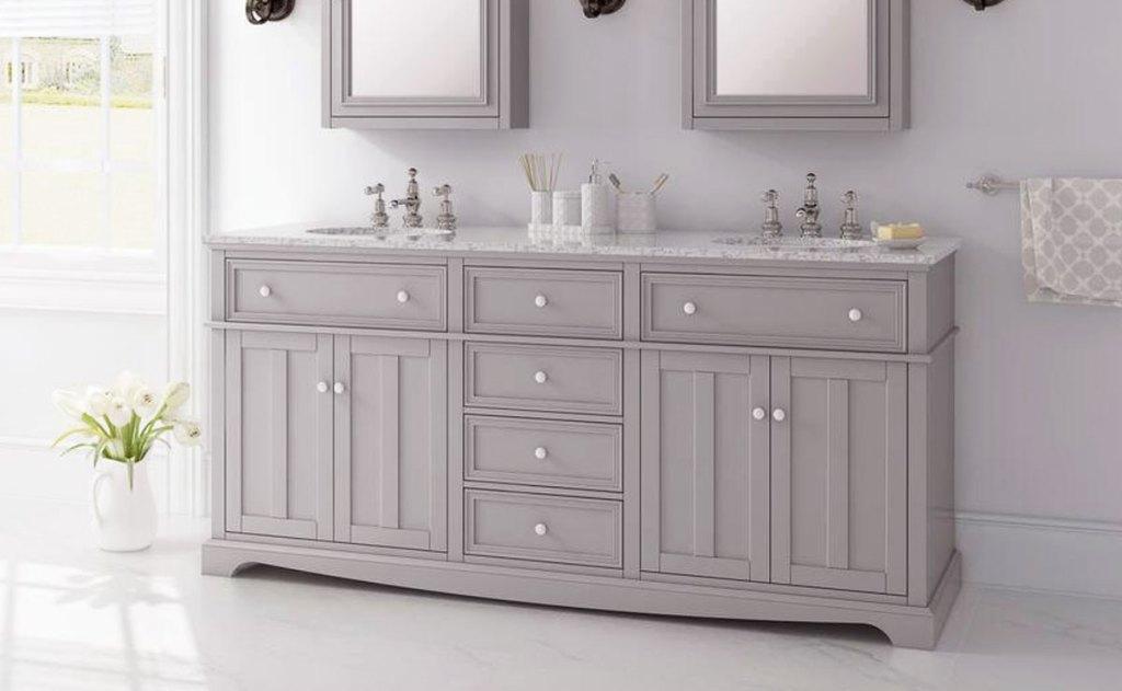 grey double bathroom vanity with nrgite counter top in a bathroom