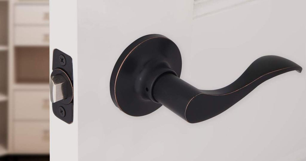 close up view of Honeywell Door Lever in Oil Rubbed Bronze on white door