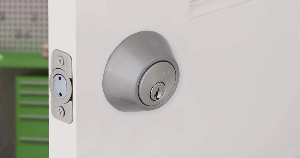close up of honeywell double cylinder deadbolt door lock on white door