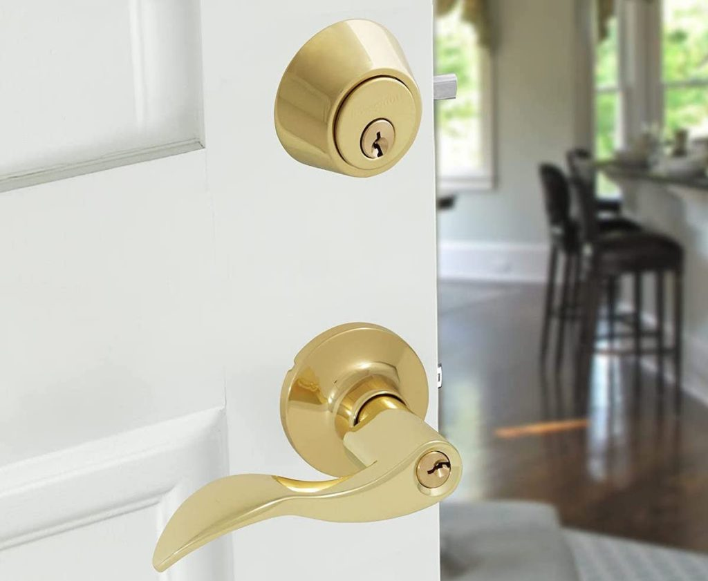 gold Honeywell Wave Combo Door Lever on white door