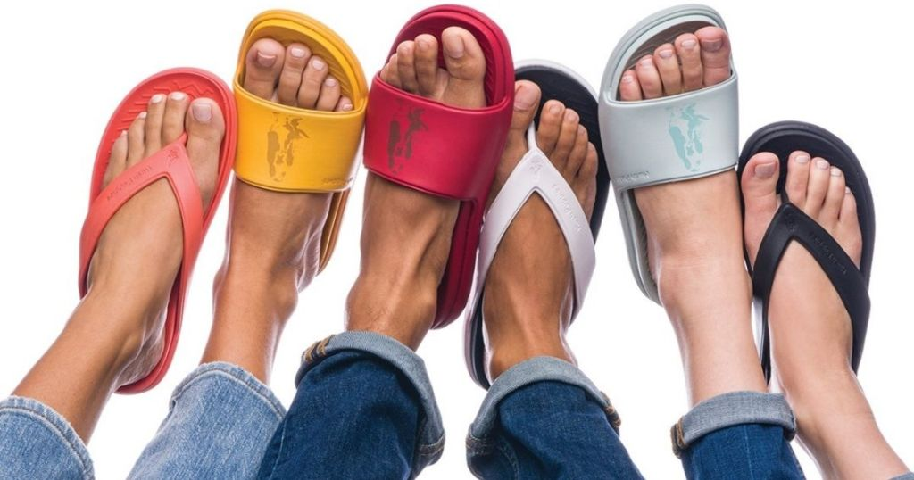 six feet wearing different styles of Hush Puppies Slides Shoes