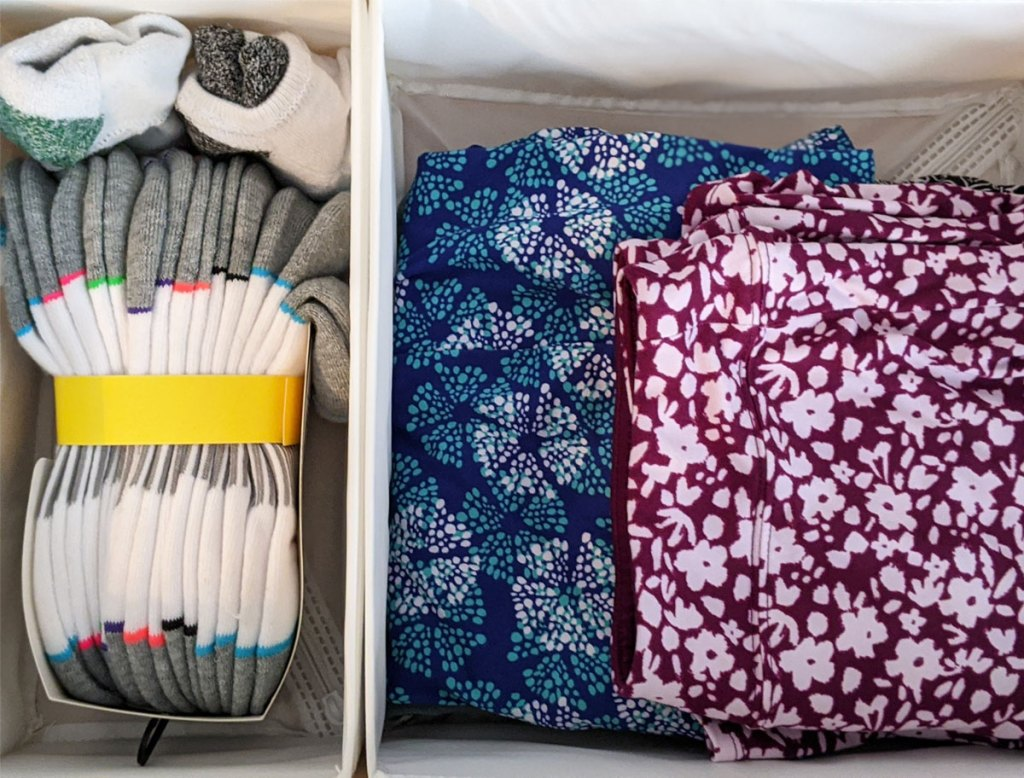 white fabric storage boxes inside dresser drawer separating out socks from folded clothes