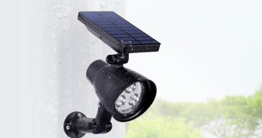 solar light mounted on side of house in the rain
