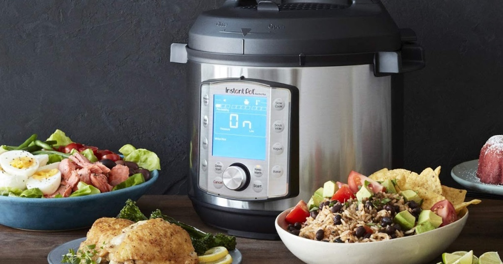 Instant Pot on counter with various foods