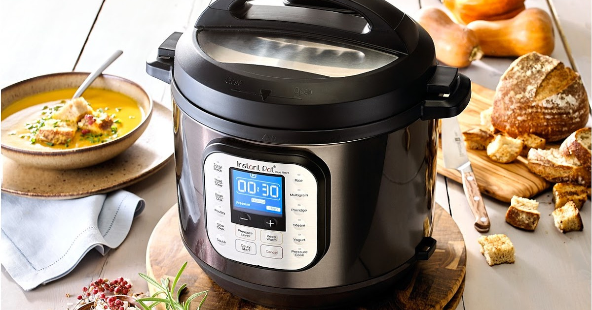 instant pot duo nova cooker sitting on a counter surrounded by food