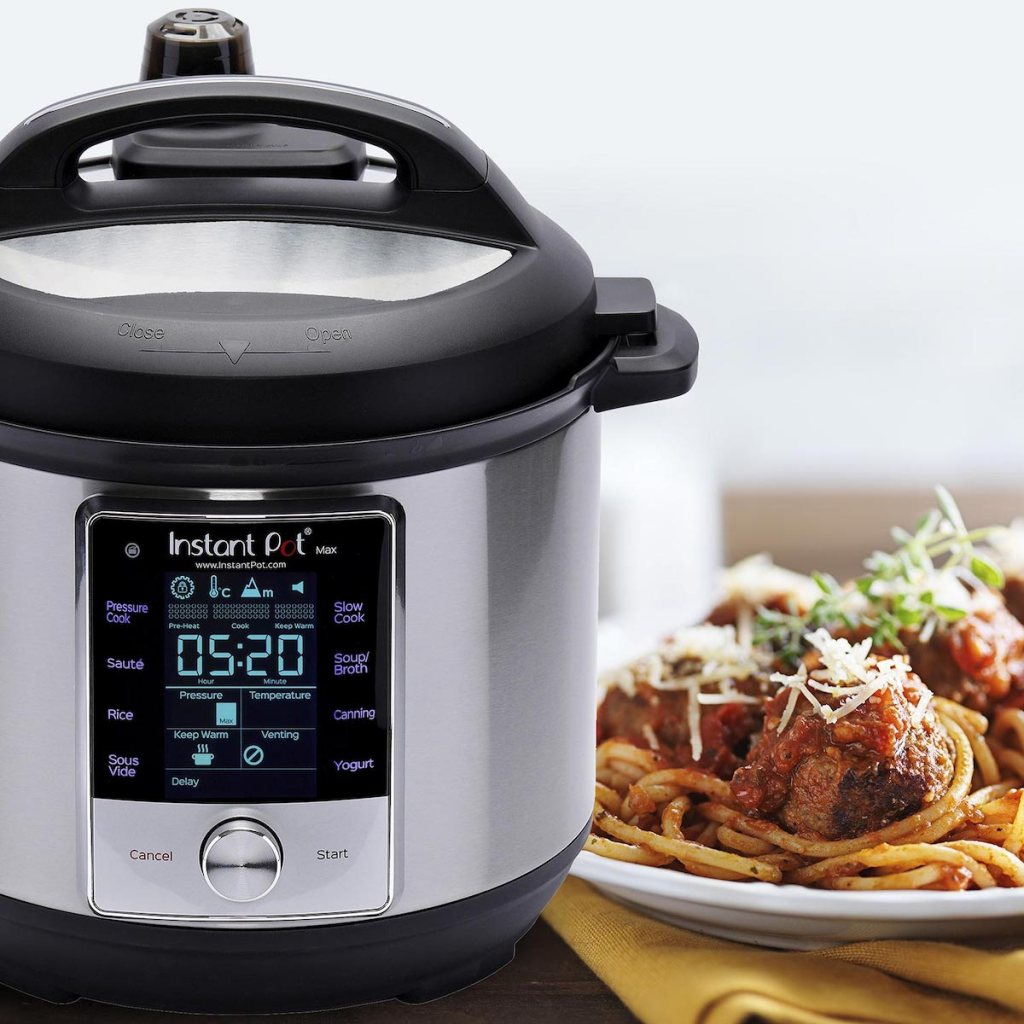 Instant Pot Max 6-Quart Programmable Pressure Cooker with a plate of spaghetti and meatballs next to it