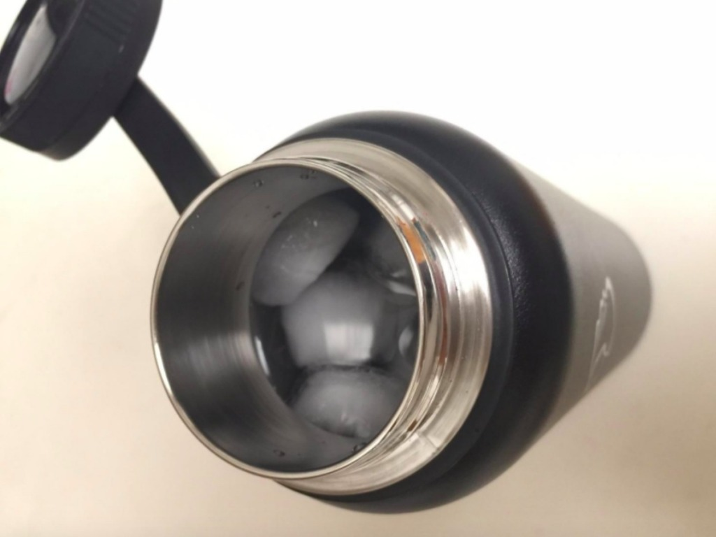 black insulated water bottle with ice in it