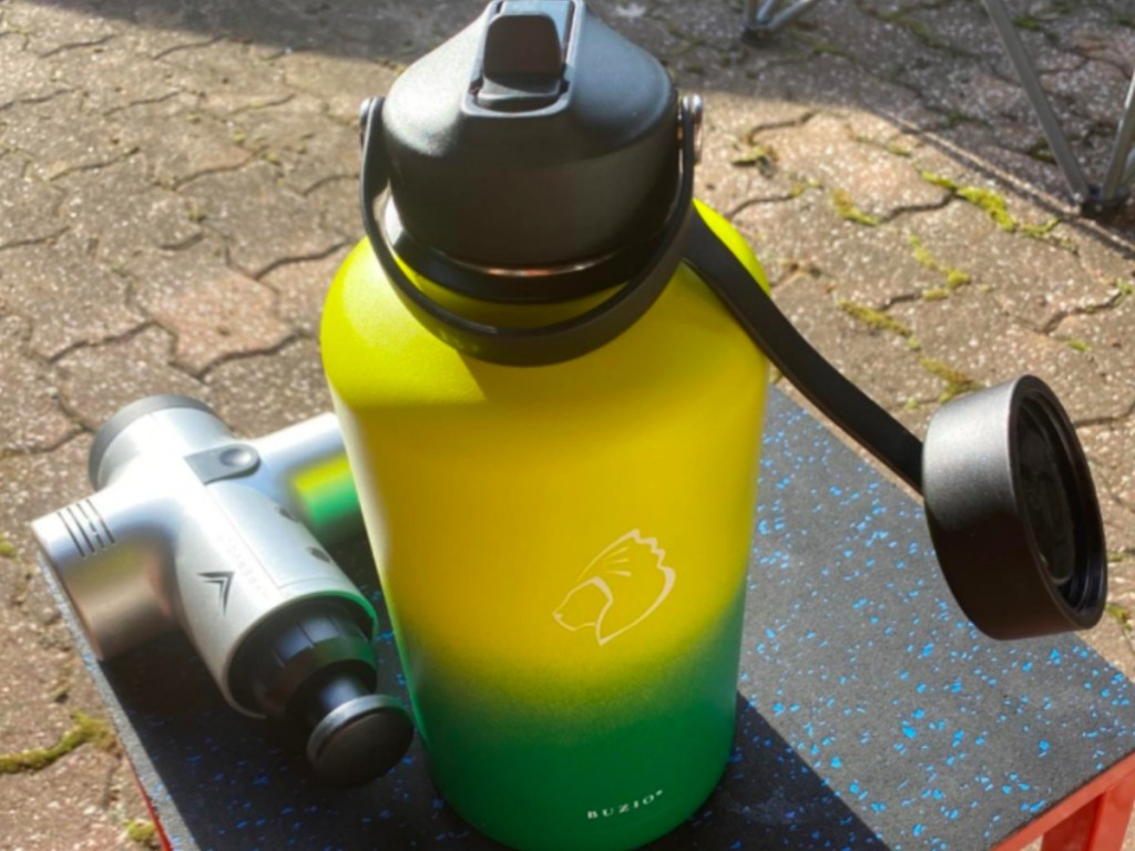green and yellow water bottle on a table