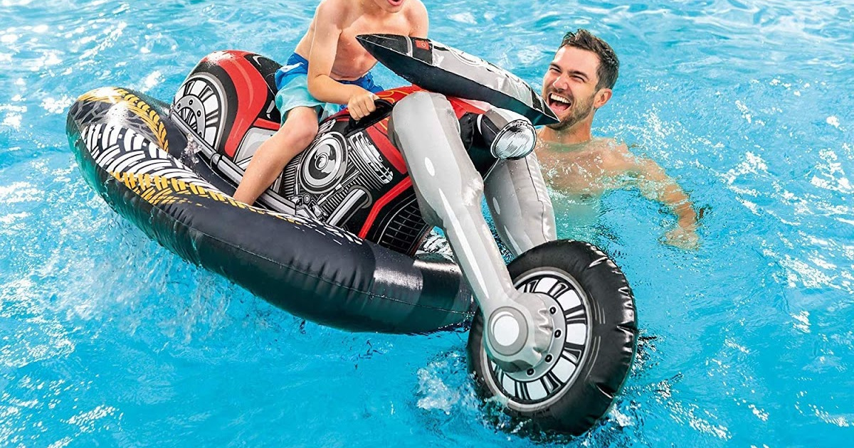 child on motorcycle float in pool and man