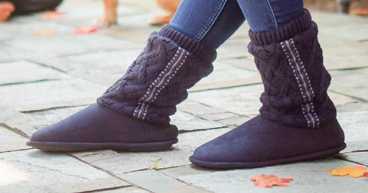 Legs wearing gray slippers