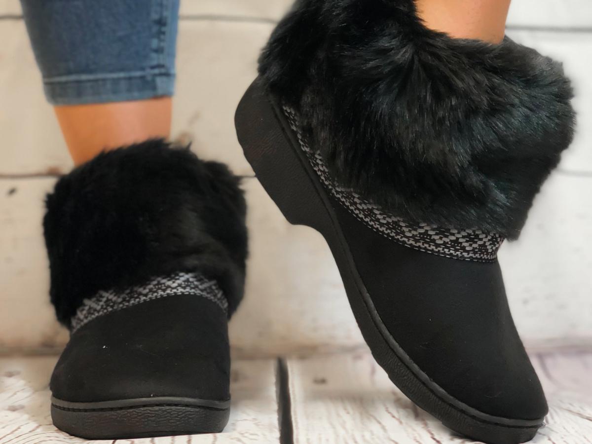 legs wearing black fluffy slippers
