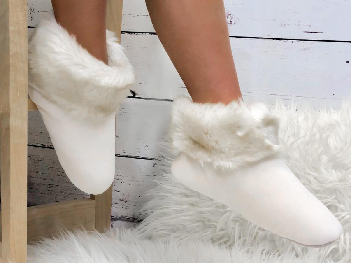 legs wearing white fluffy slippers