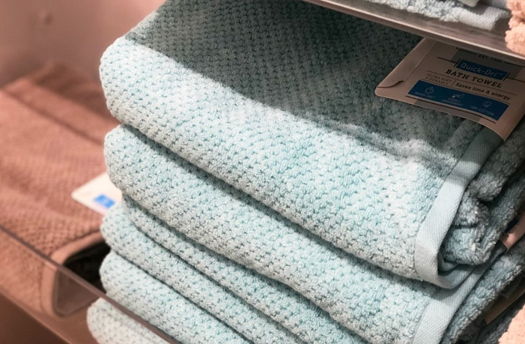 stack of folded textured bath towels in light blue color on JCPenney shelf