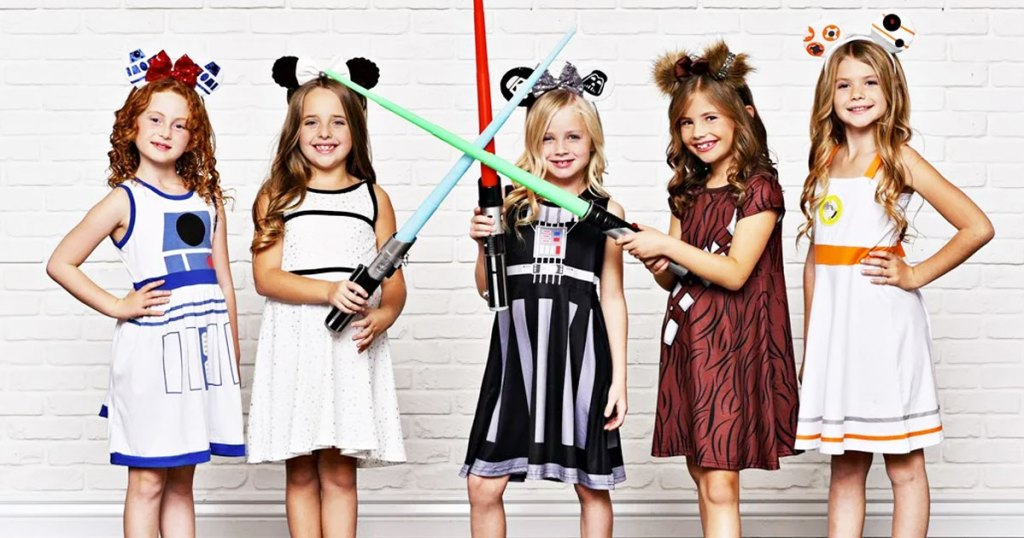 five girls wearing star wars character inspired dresses