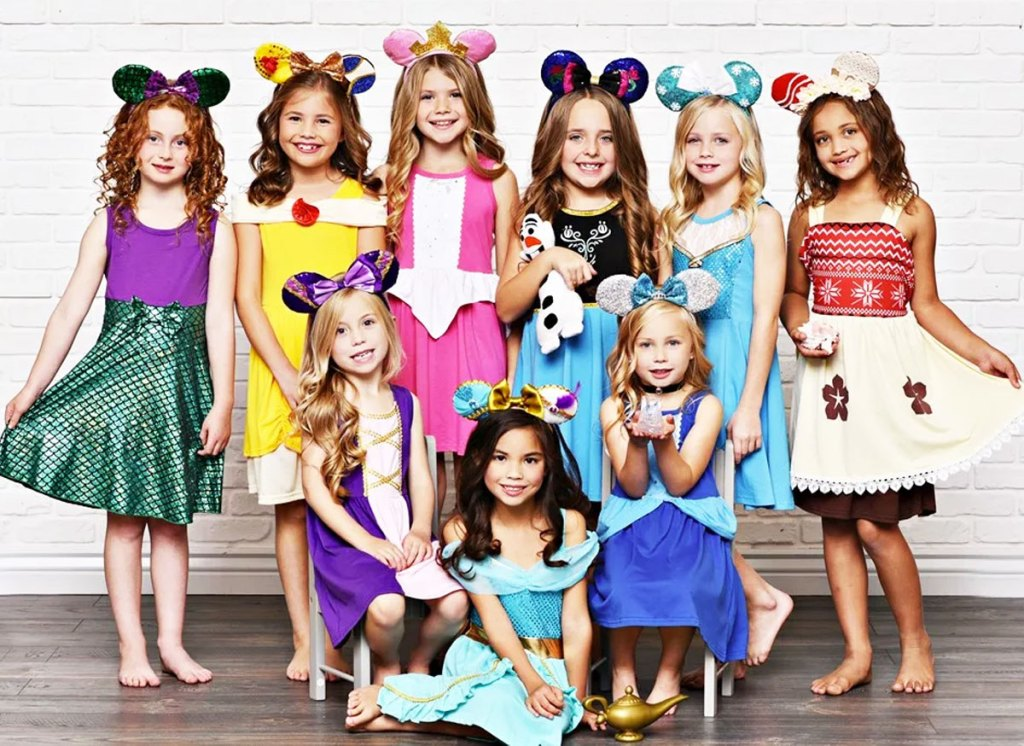 large group of girls all wearing disney princess inspired dresses