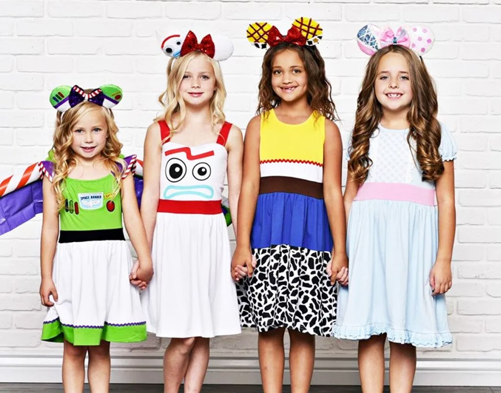 four girls wearing toy story character inspired dresses