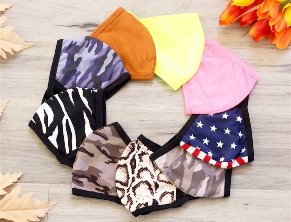 various colors and prints of reusable face masks arranged in a circle