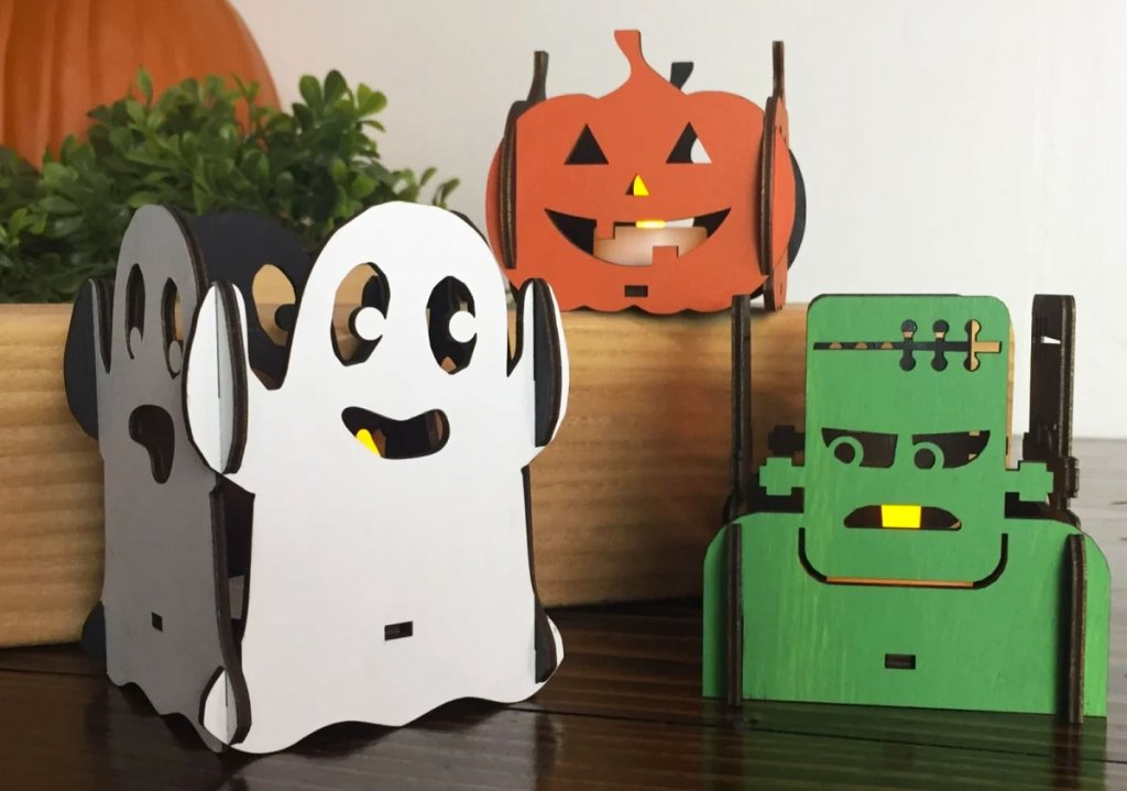wooden ghost, frankenstein, and pumpkin shaped candle holders