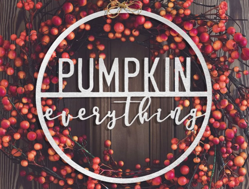 red berry wreath with round metal sign that says pumpkin everything