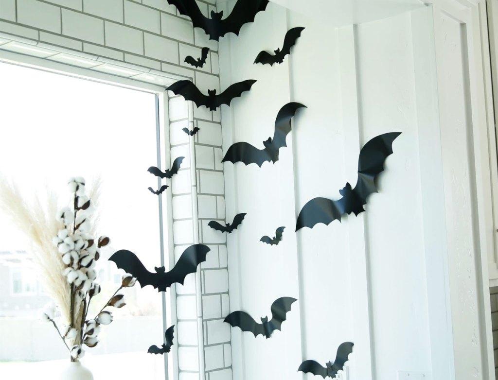 black vinyl bats stuck to wall and window