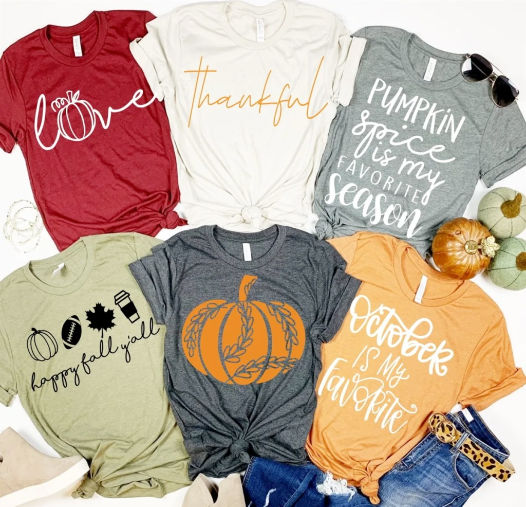 assortment of six womens tops with fall theme sayings and pumpkin graphics on them