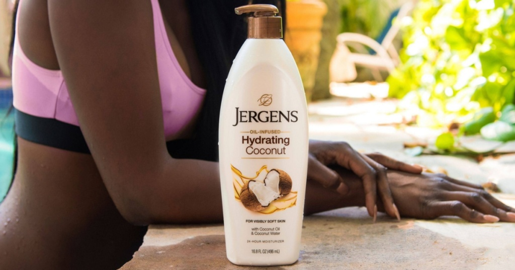 woman and bottle of coconut lotion by pool