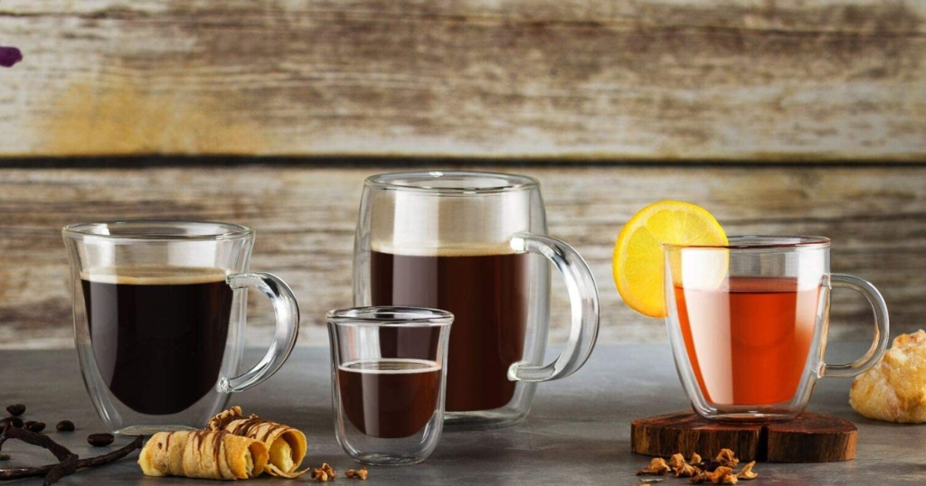 Joyjolt glassware pieces filled with different colored coffee and tea