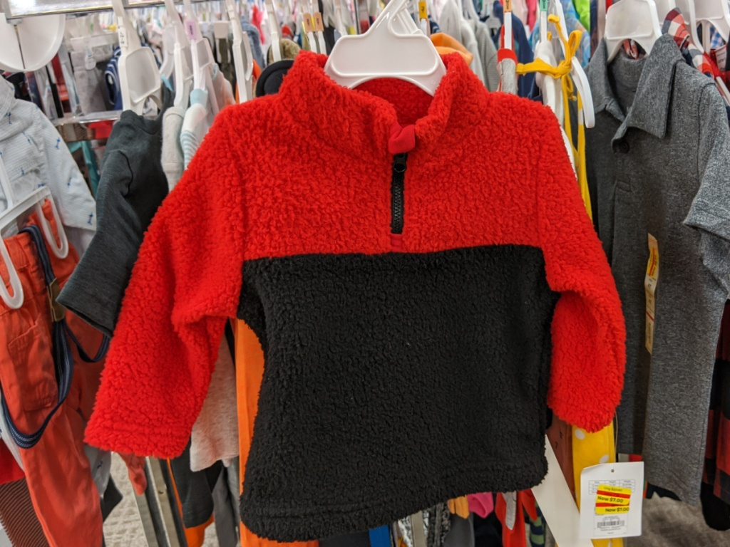 baby boy red and black sweater in hanging store