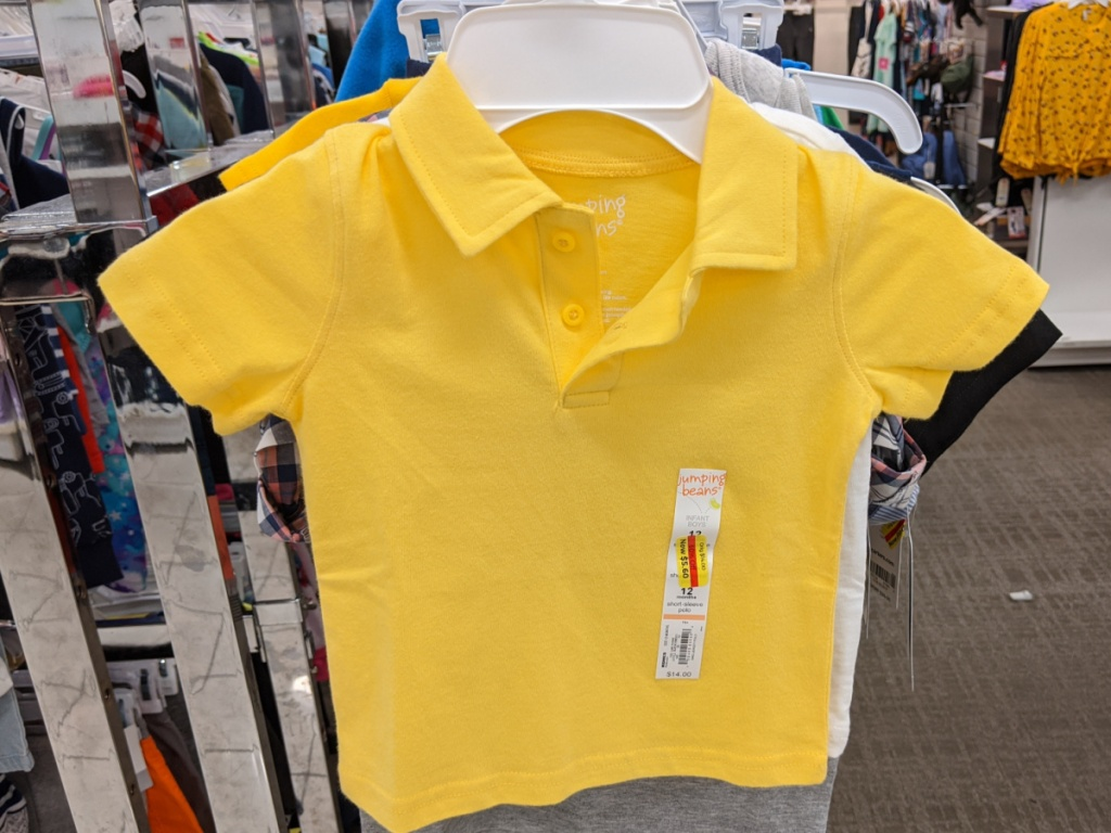 baby boys yellow polo shirt hanging in store