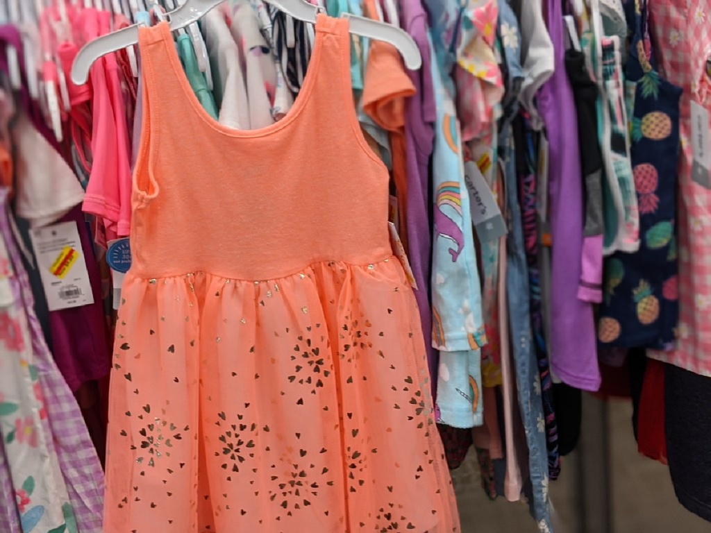 toddler girls coral tulle dress hanging in store