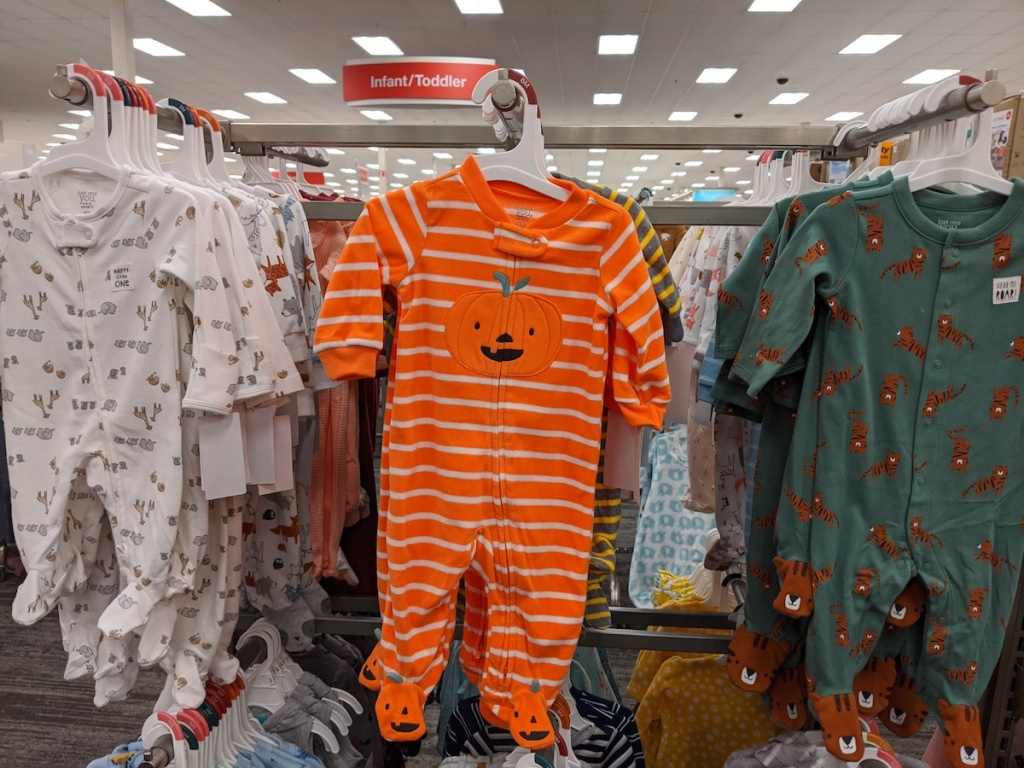 three Just One You Carter's Baby Sleep n' Play including pumpkin themed, tiger, and giraffes