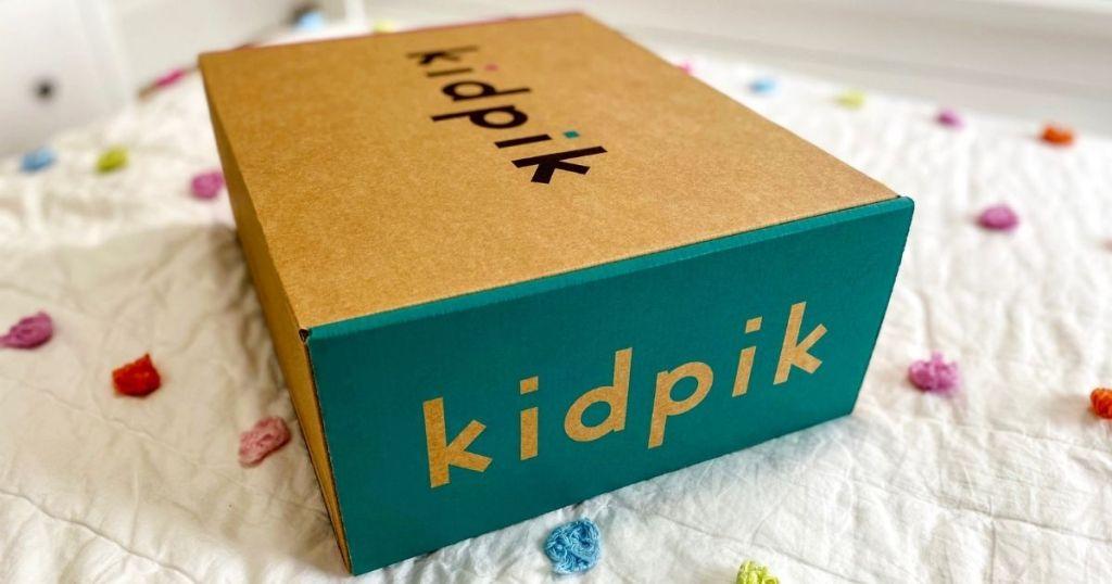 Kidpik box on a bed