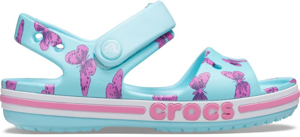 blue kids crocs with purple butterflies