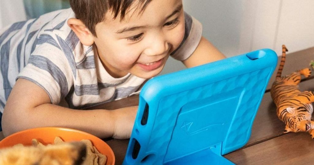 kid looking at a tablet