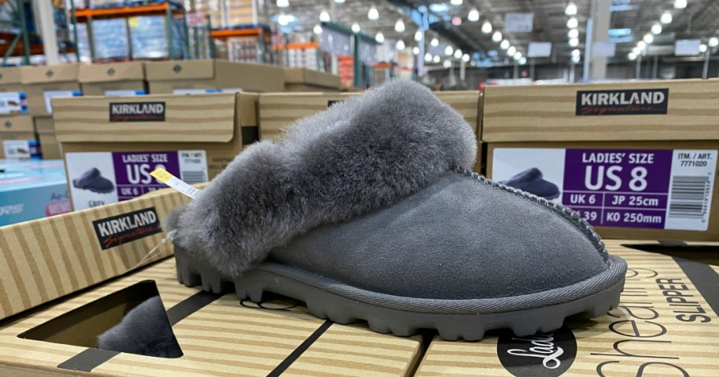 Kirkland shearling slipper on top of shoeboxes at Costco