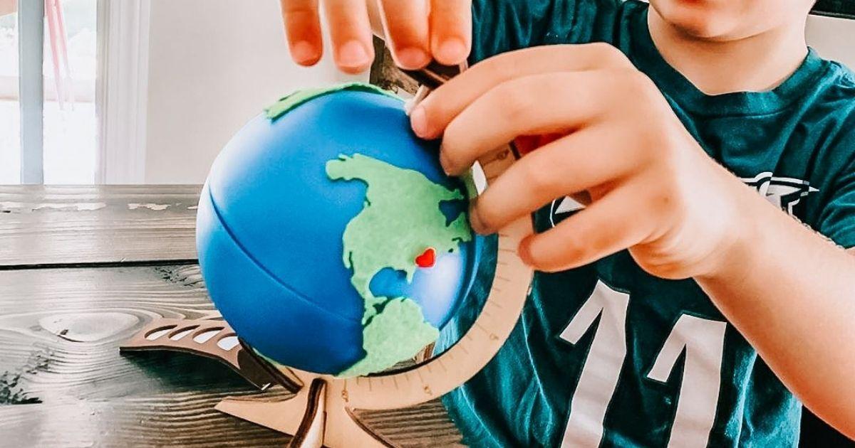 boy building globe