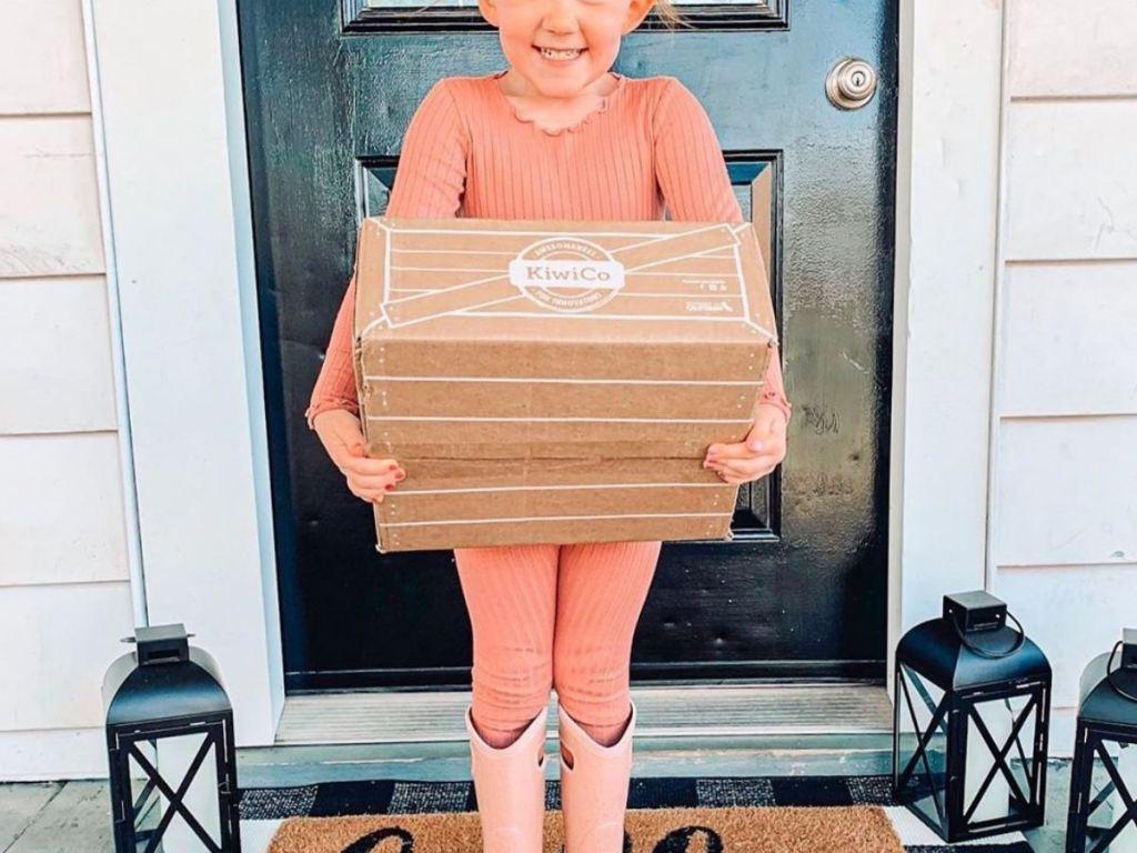 girl holding KiwiCo box