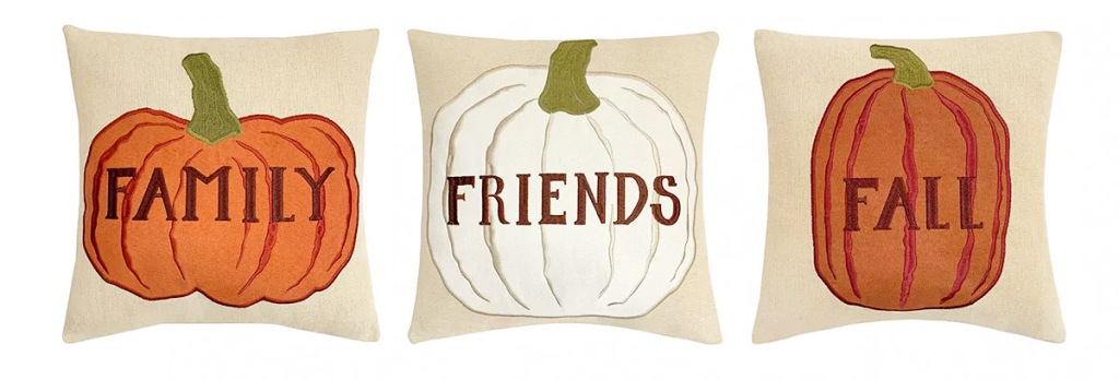 three pumpkin throw pillows that say family, friends, and fall on them