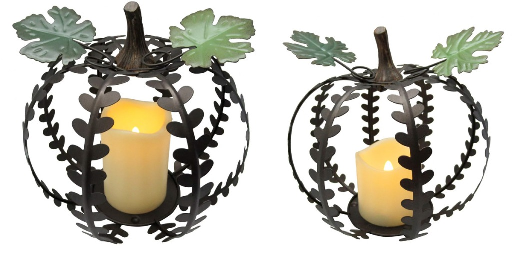 two metal pumpkin shaped decor pieces with led pillar candles inside