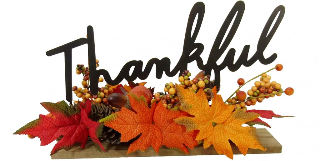 tabler decor piece with leaves and pumpkins that says thankful in black letters