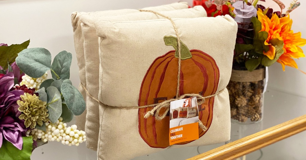 pumpkin throw pillow 3-pack on kohl's shelf near fall flowers