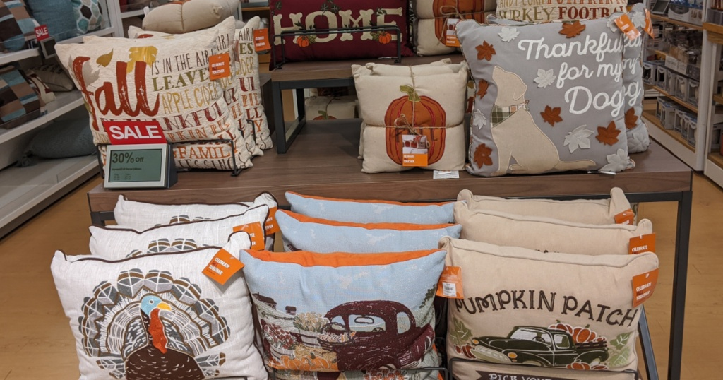 Fall and Halloween season throw pillows on table in store