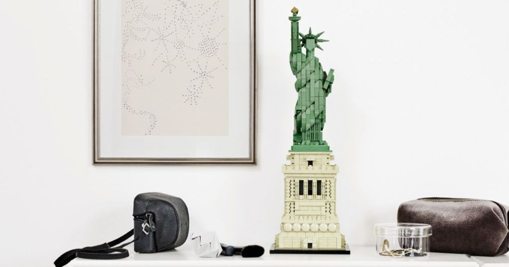 LEGO Statue of Liberty on table by camera bag
