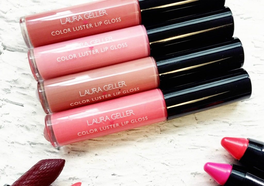 various pink and nude shades of Laura Geller lip glosses