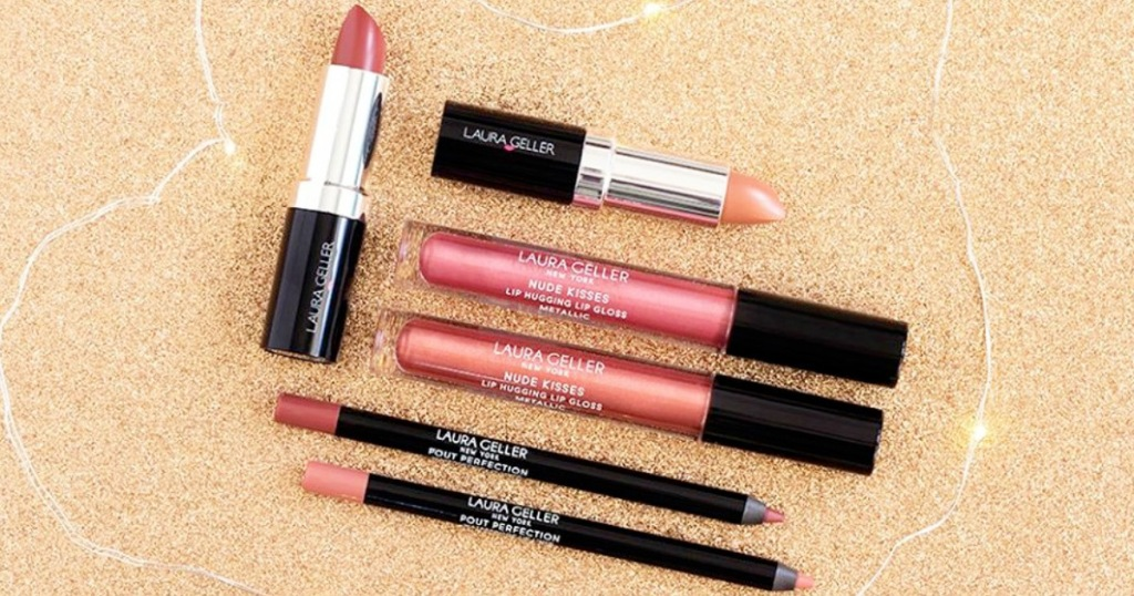 Laura Geller lip glosses, lipsticks, and lip liners on sparkly background