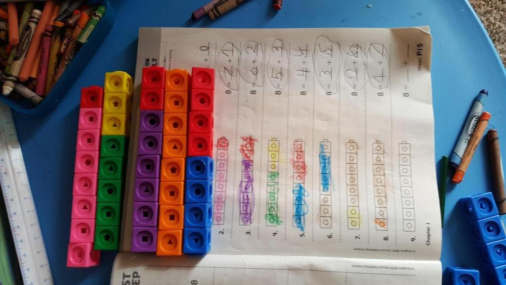 Learning Resources 100-Piece Math link Cubes on notebook