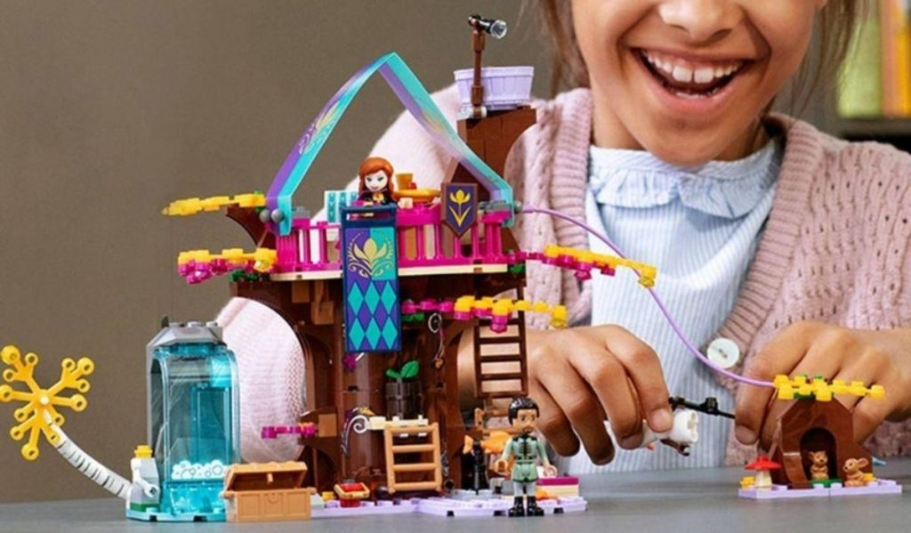 Little girl playing with lego playset