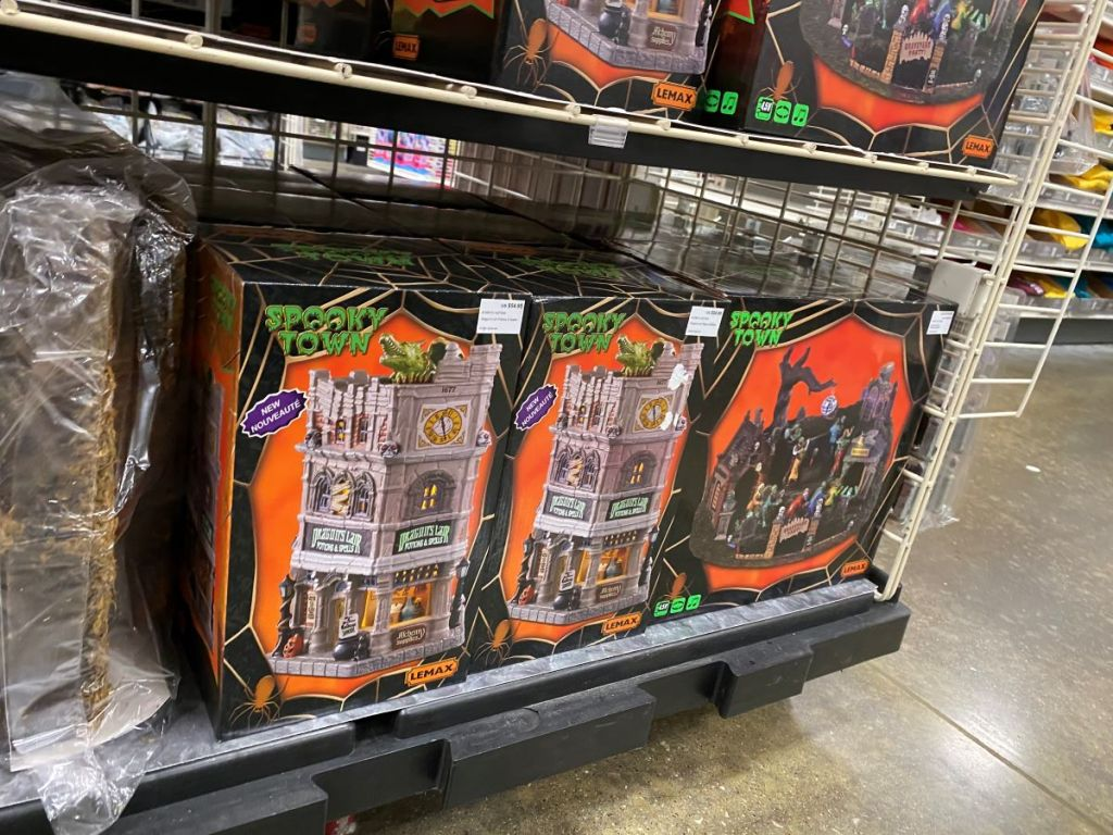 Lemax Halloween houses on shelf at Michaels