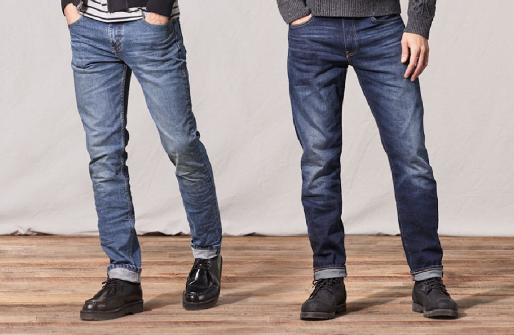 two men wearing Levi's Men's 502 Taper Jeans