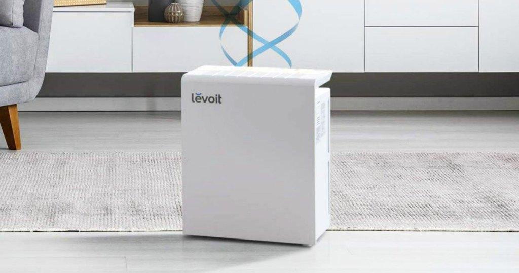 white rectangular air purifier on carpet